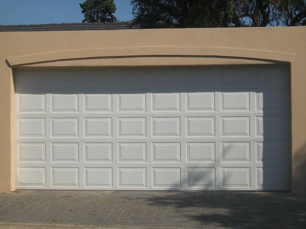 Double steele garage door per door eec secure gate for Two door garage
